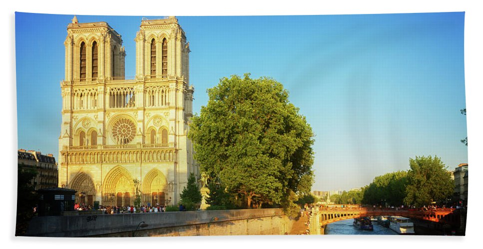 Notre-dame Hand Towel featuring the photograph Notre Dame In Sunset Light by Anastasy Yarmolovich