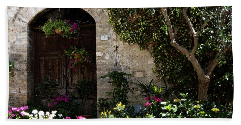 Flower Bath Towel featuring the photograph Italian Front Door Adorned With Flowers by Marilyn Hunt