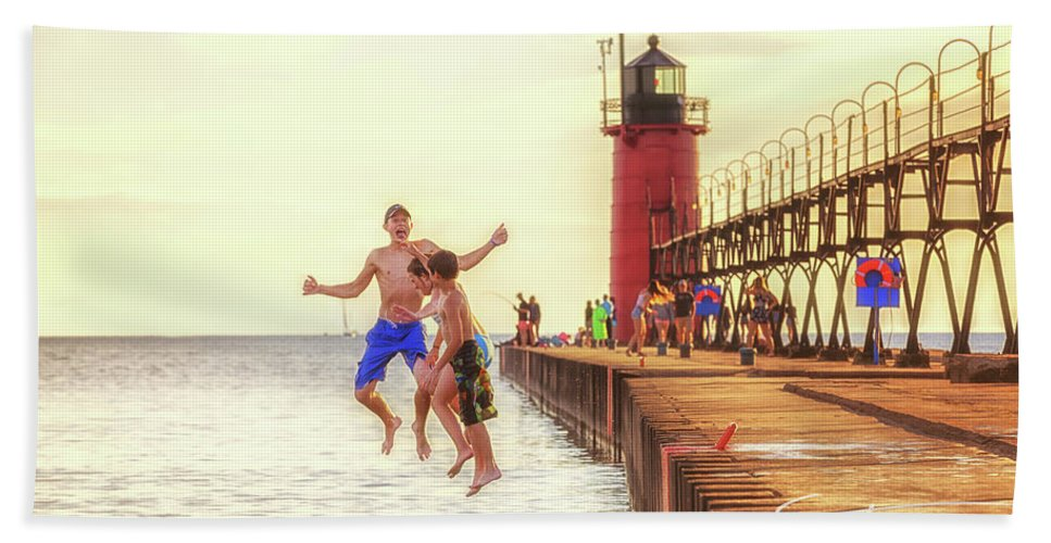South Haven Lighthouse Bath Sheet featuring the photograph Jump by J Thomas