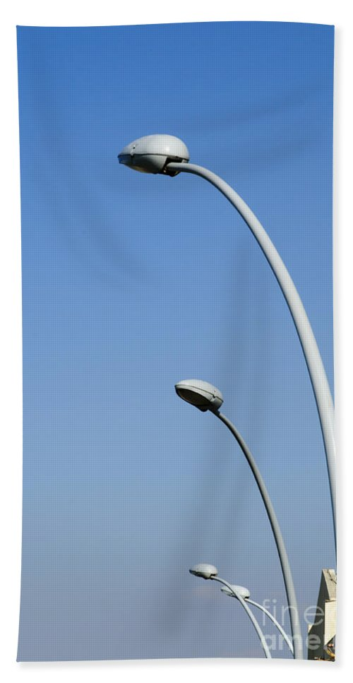Lamp Hand Towel featuring the photograph Lamp Posts On Blue Sky by Ilan Rosen