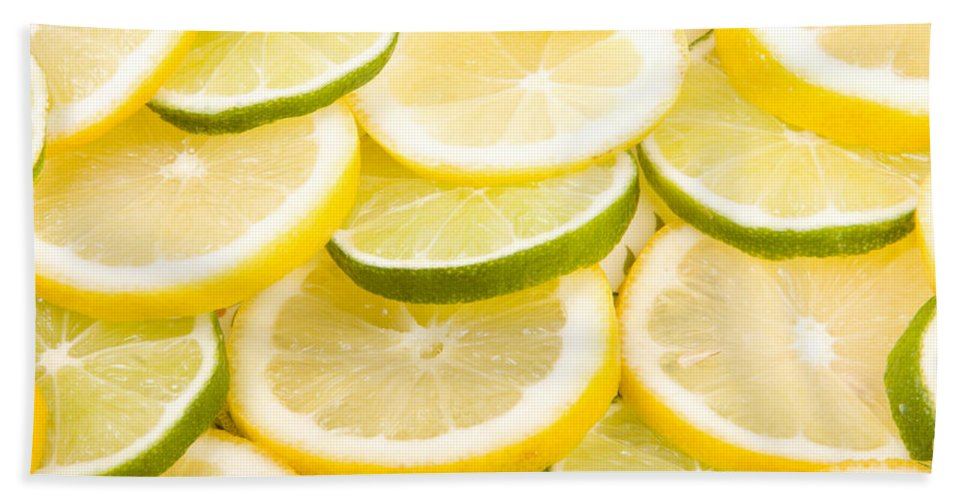 Lemons; Citrus; Citrus Fruit; Citrus Fruits; Close Up; Cross Section; Culinary; Food; Fruit; Fruits; Green; Key Lime; Key Limes; Lime; Limes; Slice; Sliced; Slices; Group; Sour Bath Sheet featuring the photograph Lemons And Limes by James BO Insogna