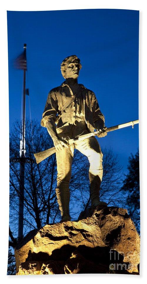 Minuteman Hand Towel featuring the photograph Lexington Minuteman by Brian Jannsen