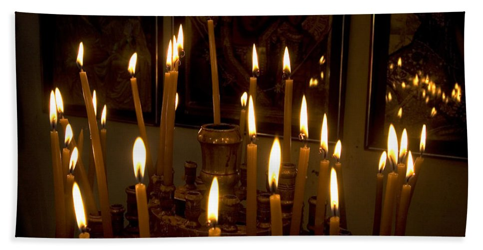 Lit Bath Towel featuring the photograph lit Candles in church by Danny Yanai