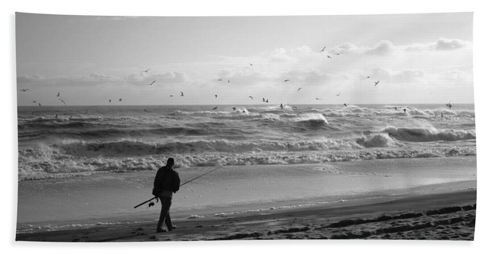 Sea Bath Towel featuring the photograph Lone Fisherman by Linda C Johnson