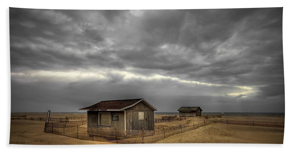Beach Hand Towel featuring the photograph Lonely Beach Shacks by Evelina Kremsdorf