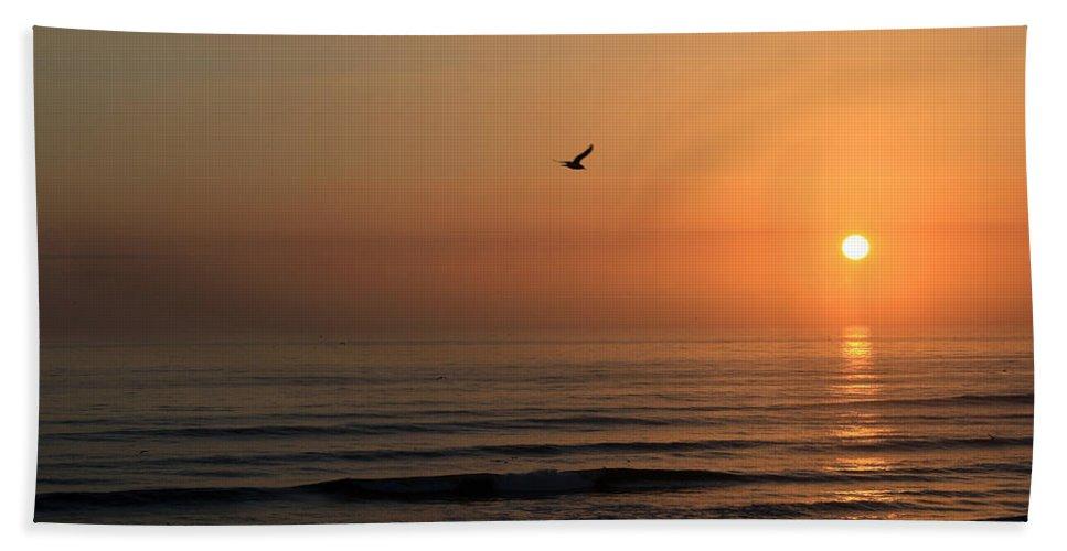 Bird Fly Flight Gull Alone Sun Sunrise Sky Ocean Wave Reflection Nature Golden Gold Bath Sheet featuring the photograph Lonely Flight by Andrei Shliakhau
