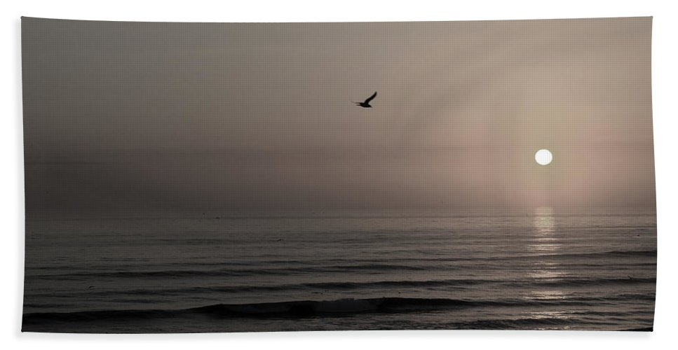 Beach Ocean Wave Sunrise Sunset Sun Bird Gull Fly Flight Water Vacation Peace Nature Relax Peace Bath Towel featuring the photograph Lonely Flight II by Andrei Shliakhau