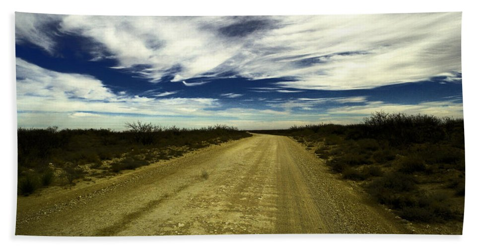 New Mexico Bath Sheet featuring the photograph Long Dusty Road In Jal New Mexico by Jeff Swan