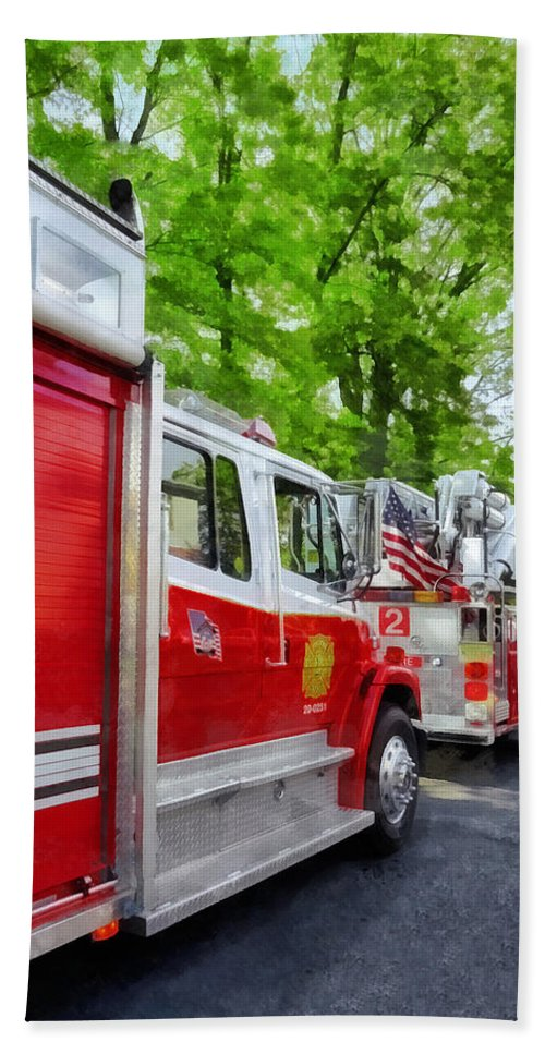 Fire Engine Hand Towel featuring the photograph Long Line Of Fire Trucks by Susan Savad
