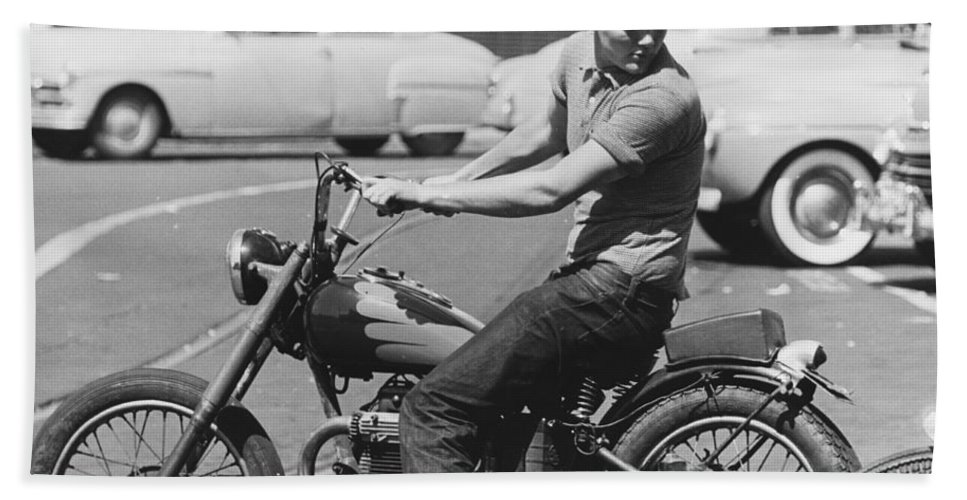 1 Person Hand Towel featuring the photograph Man Riding A Motorcycle by Underwood Archives
