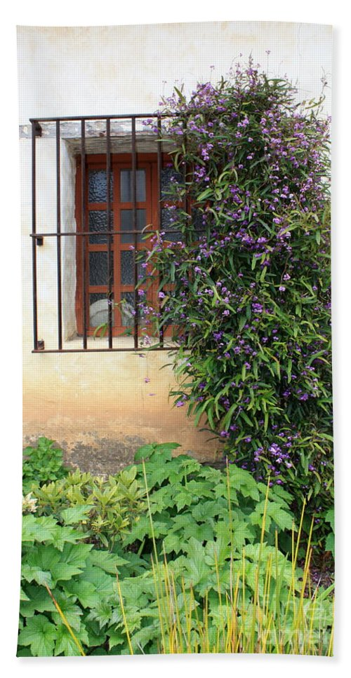 Mission Hand Towel featuring the photograph Mission Window With Purple Flowers Vertical by Carol Groenen