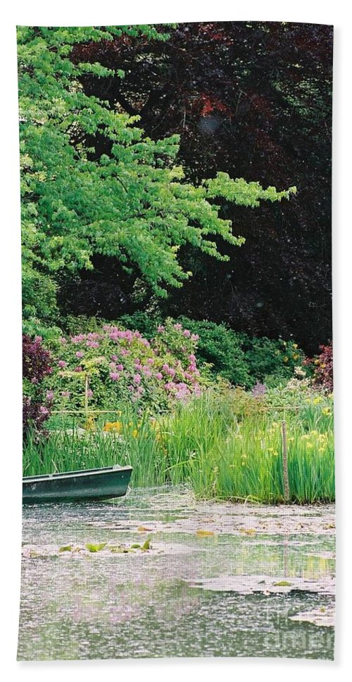 Monet Bath Sheet featuring the photograph Monet's Garden Pond And Boat by Nadine Rippelmeyer
