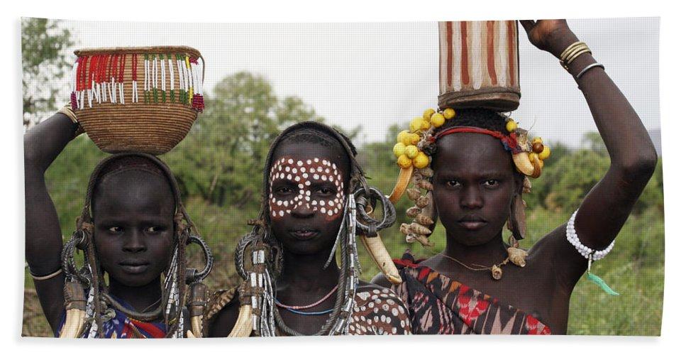 Ethiopia Bath Towel featuring the photograph Mursi Tribesmen In Ethiopia by Gilad Flesch
