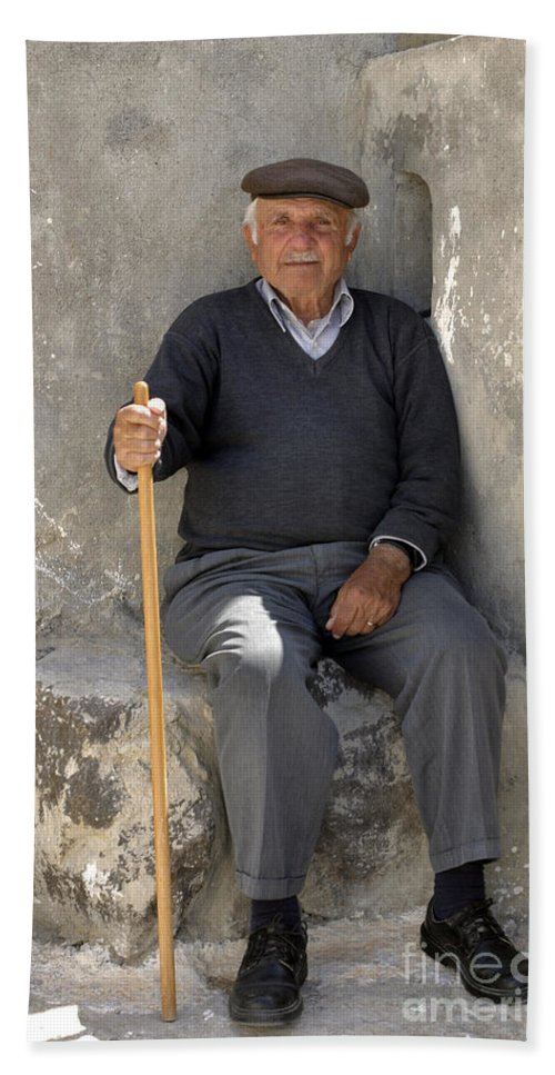 Man Bath Sheet featuring the photograph Mykonos Man With Walking Stick by Madeline Ellis