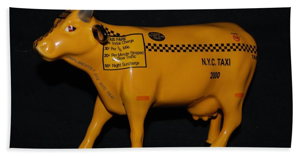 Macro Hand Towel featuring the photograph N Y C Taxi Cow by Rob Hans