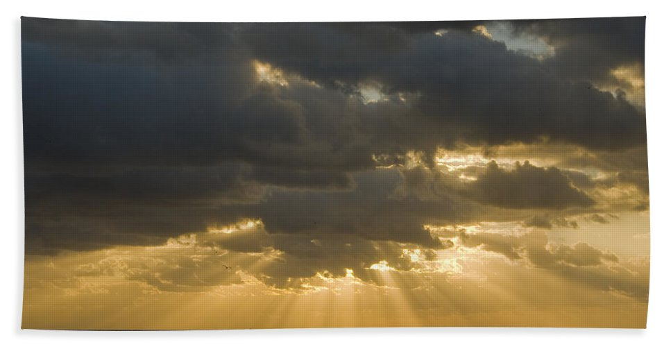 Ocean Sunset Sun Cloud Clouds Ray Rays Beam Beams Bright Wave Waves Water Sea Beach Golden Nature Bath Sheet featuring the photograph New Beginning by Andrei Shliakhau