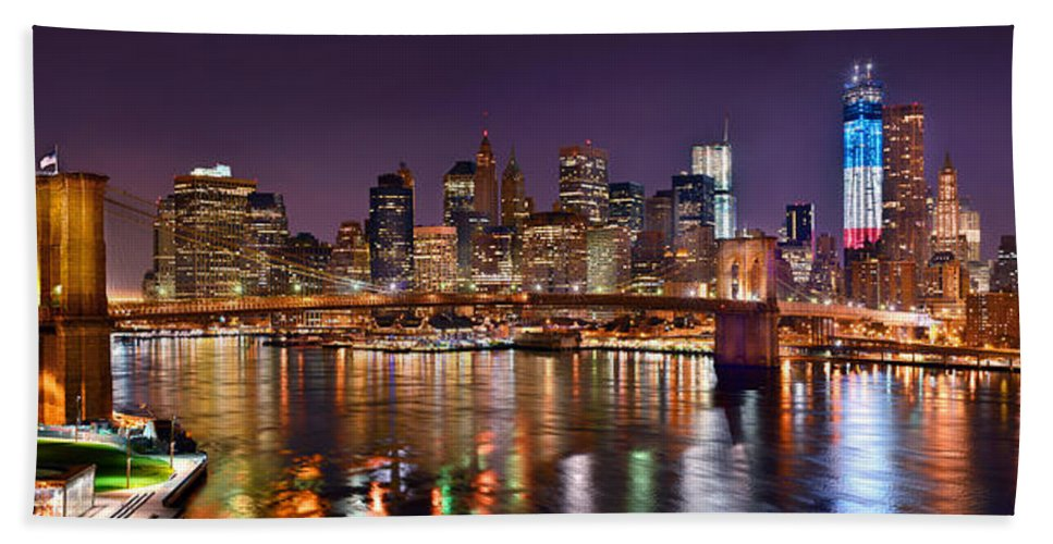 New York City Skyline At Night Hand Towel featuring the photograph New York City Brooklyn Bridge And Lower Manhattan At Night Nyc by Jon Holiday