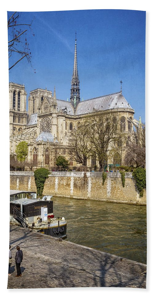 Joan Carroll Hand Towel featuring the photograph Notre Dame And The Seine by Joan Carroll