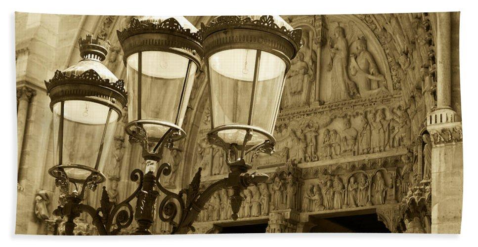 Paris Hand Towel featuring the photograph Notre Dame Street Lights Paris France Sepia by Toby McGuire