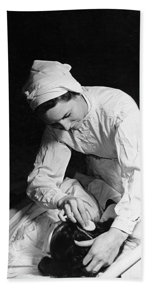1930s Hand Towel featuring the photograph Nurse Tending To A Patient by Underwood Archives