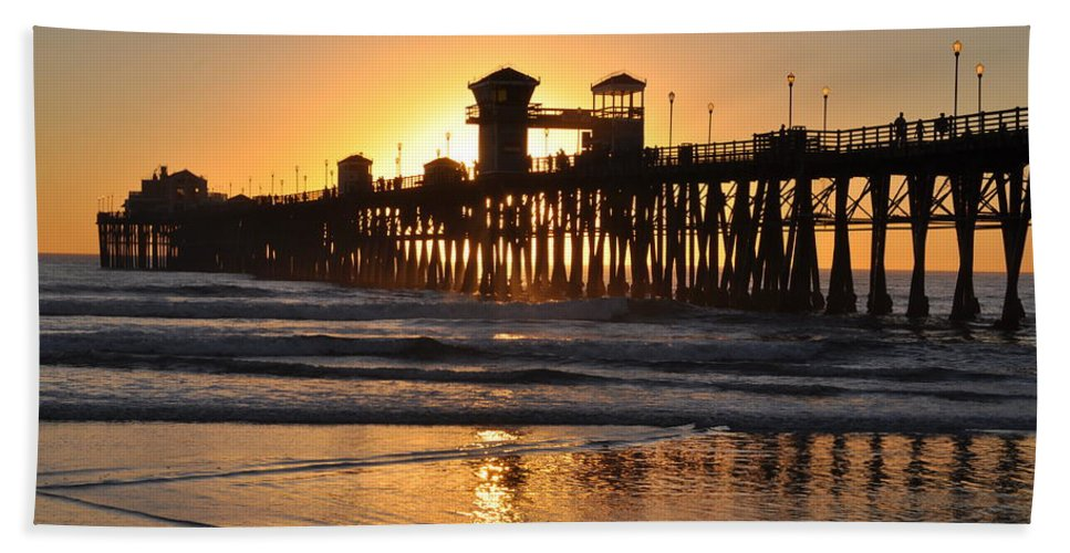 Silhouette Hand Towel featuring the photograph Oceanside Pier by Bridgette Gomes