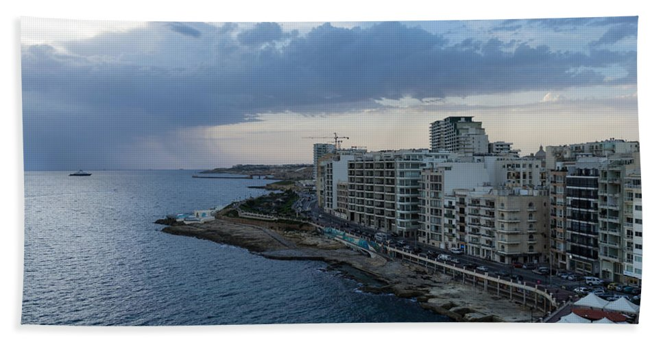 Offshore Rainstorm Bath Sheet featuring the photograph Offshore Rainstorm - Sliema's Famous Promenade Waking Up by Georgia Mizuleva