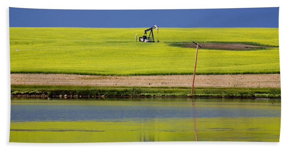 Industry Bath Sheet featuring the photograph Oil Jack Reflection Saskatchewan by Mark Duffy