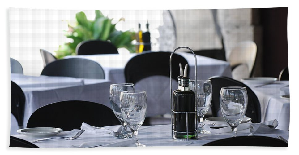 Tables Hand Towel featuring the photograph Oils And Glass At Dinner by Rob Hans