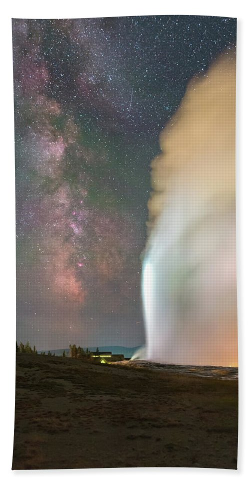 Astrophotography Hand Towel featuring the photograph Old Faithful Erupts At Night by Alex Conu