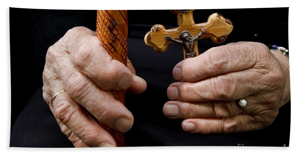 Old Hand Towel featuring the photograph Old Hands And Crucifix by Danny Yanai