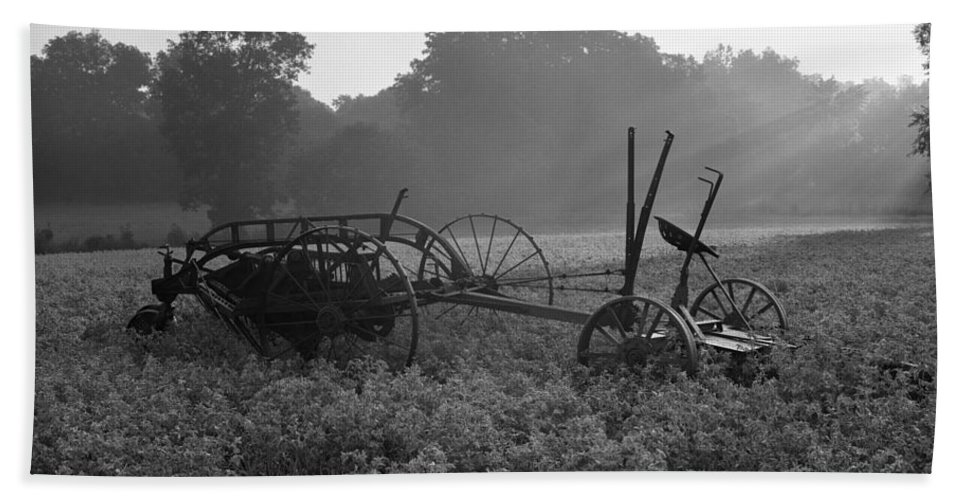 Agriculture Bath Sheet featuring the photograph Old Hay Baler In Misty Field by H Armstrong Roberts and ClassicStock