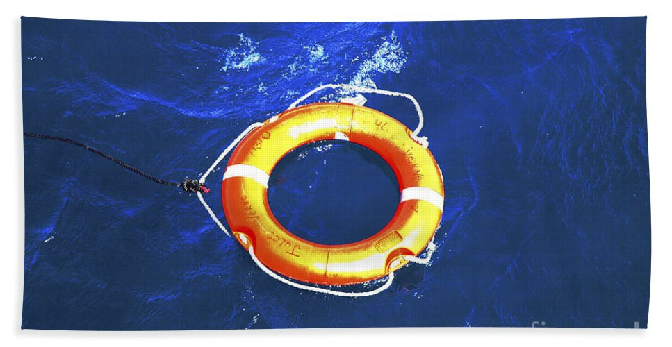 Orange Bath Towel featuring the photograph Orange Life Buoy In Blue Water by Jacki Costi