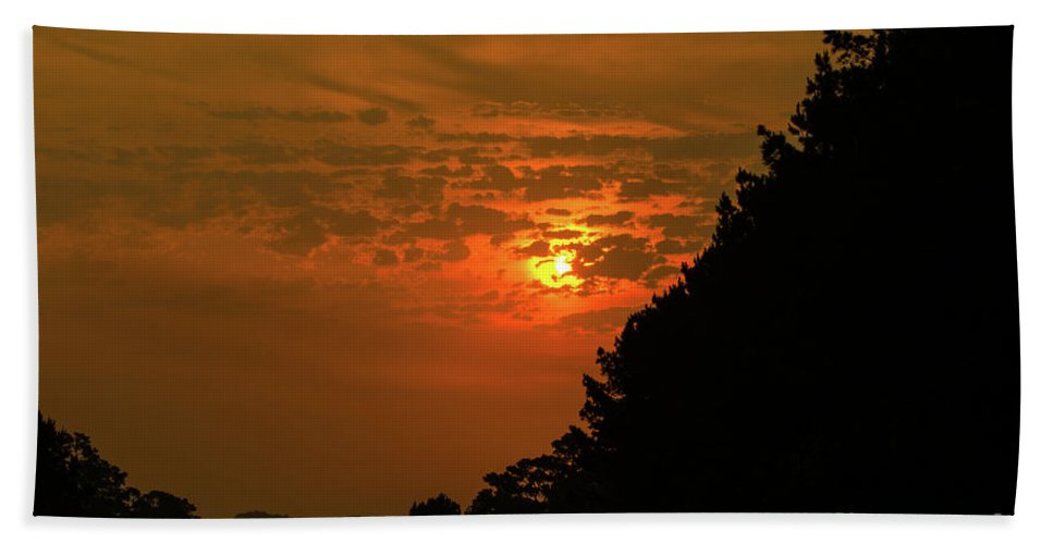 Orange Bath Sheet featuring the photograph Orange Sunset With Tree Silhouette by Debby Harrison