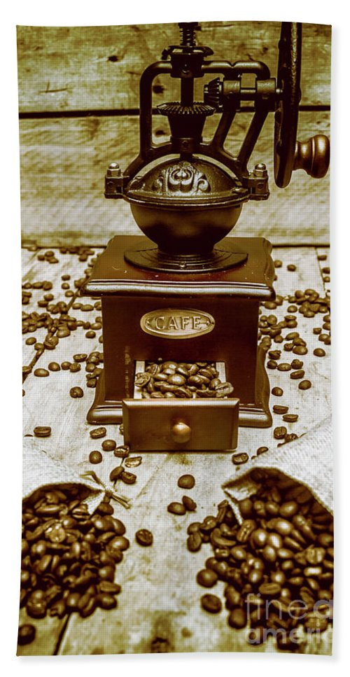 Aromatic Hand Towel featuring the photograph Pair Coffee Bean Bags Spilled In Front Of Grinder by Jorgo Photography - Wall Art Gallery