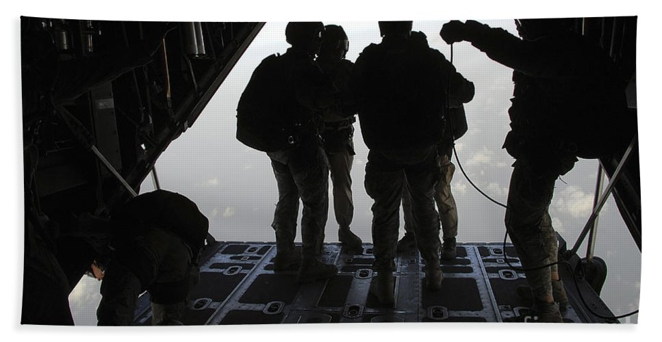 Hc-130 Bath Sheet featuring the photograph Pararescuemen Prepare For A Halo Jump by Stocktrek Images