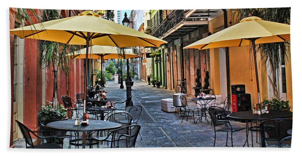 Patio Bath Sheet featuring the photograph Patio Cafe In Nola by Judy Vincent