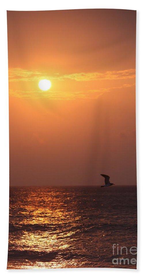 Birds Bath Towel featuring the photograph Peach Sunrise And Bird In Flight by Nadine Rippelmeyer