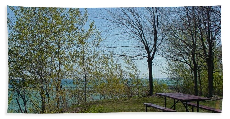 Lake View Bath Sheet featuring the photograph Picnic Table By The Lake Photo by Anita Burgermeister