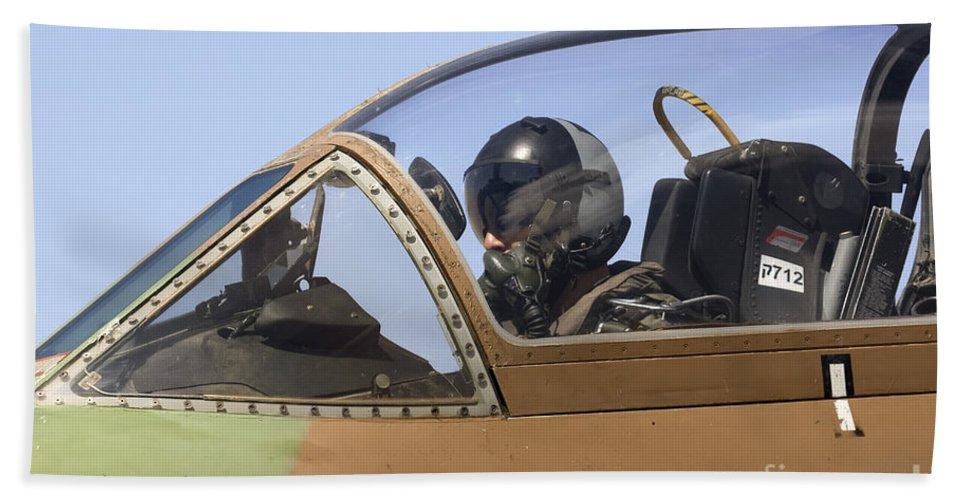 Aircraft Bath Sheet featuring the photograph Pilot In The Cockpit Of A Skyhawk Fighter Jet by Nir Ben-Yosef