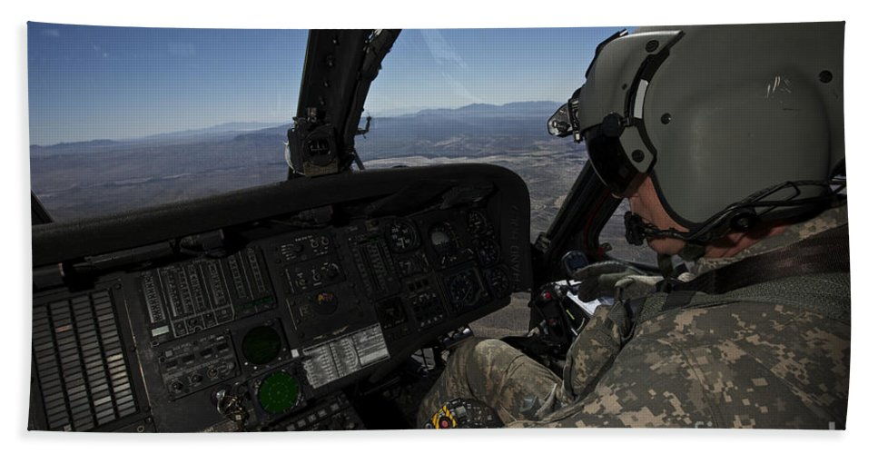 Exercise Angel Thunder Bath Sheet featuring the photograph Pilot Operating The Cockpit Of A Uh-60 by Terry Moore