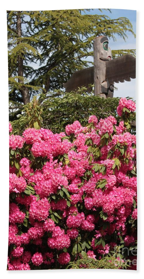Northwest Bath Sheet featuring the photograph Pink Rhododendrons With Totem Pole by Carol Groenen
