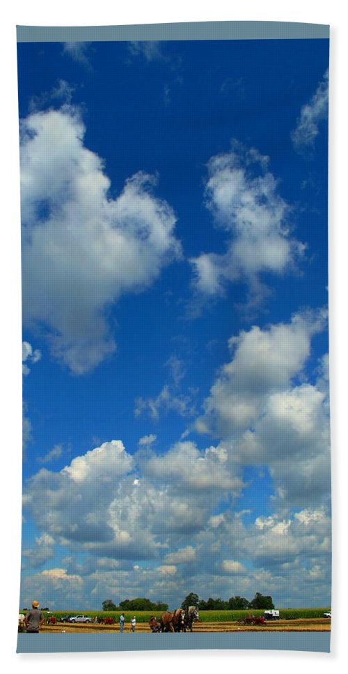 Clouds Hand Towel featuring the photograph Ploughing Under A Mid Day Sun by Ian MacDonald