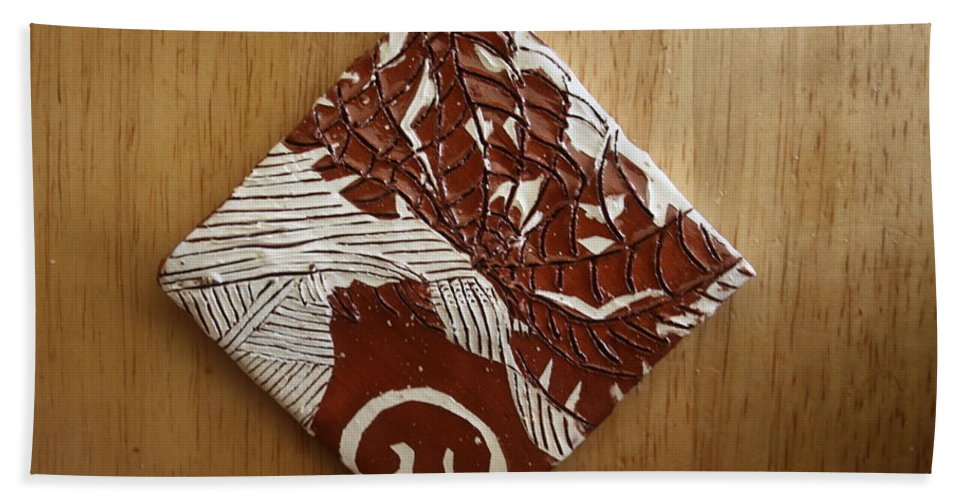 Jesus Hand Towel featuring the ceramic art Princess Nambi - Tile by Gloria Ssali