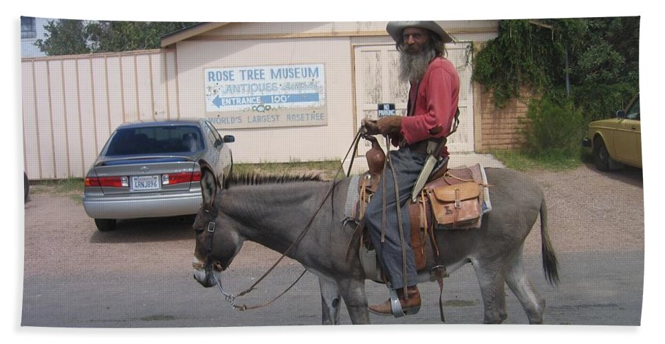 Prospector Re-enactor With Burro Passing Rose Bush Museum Sign Tombstone Arizona 2004 Hand Towel featuring the photograph Prospector Re-enactor With Burro Passing Rose Bush Museum Sign Tombstone Arizona 2004 by David Lee Guss