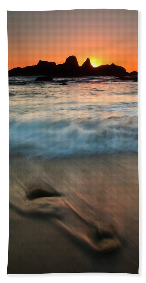 Seal Rock Hand Towel featuring the photograph Pulled By The Tides by Mike Dawson