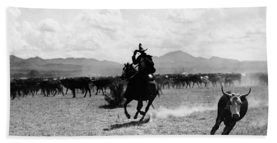 Raguero Cutting Out A Cow From The Herd (b/w Photo)wild West; Stetson; Cattle; Gallop; Round-up; Cowboy; Herding; Cattle; Plains; Old West; Western; Horse; Horseback; Rider; Riding; American Landscape; Atmospheric; Rustler Hand Towel featuring the photograph Raguero Cutting Out A Cow From The Herd by Raguero cutting out a cow from the herd