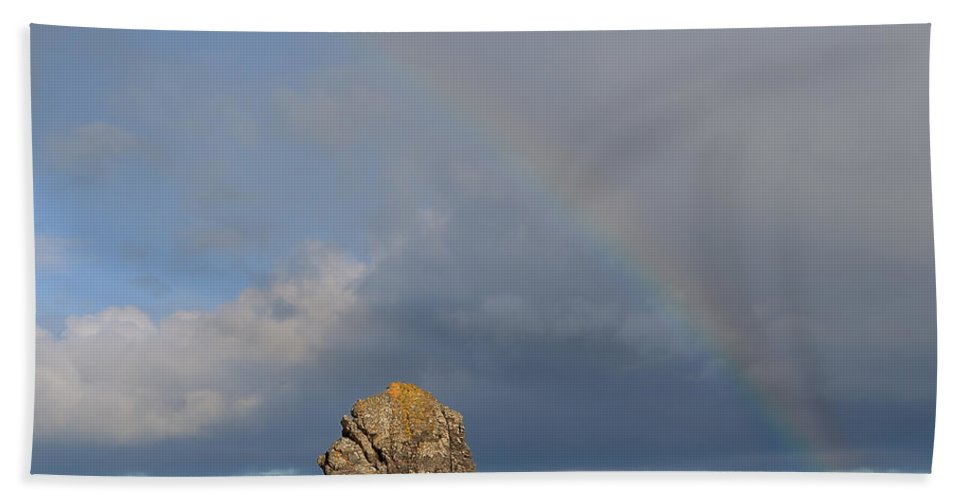 Durness Hand Towel featuring the photograph Rainbow Above Sango Bay Sea Stack by Maria Gaellman