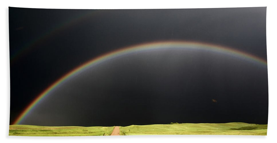 Rainbow Hand Towel featuring the digital art Rainbow And Darkened Skies Seen Down A Country Road by Mark Duffy