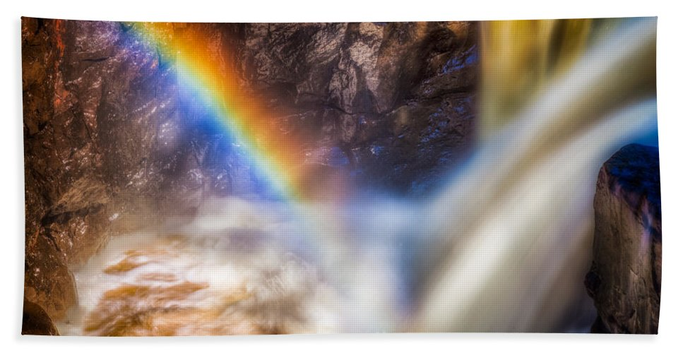 Atmosphere Hand Towel featuring the photograph Rainbow And Falls by Rikk Flohr