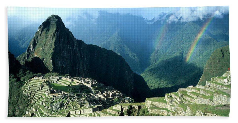 Machu Picchu Bath Towel featuring the photograph Rainbow Over Machu Picchu by James Brunker